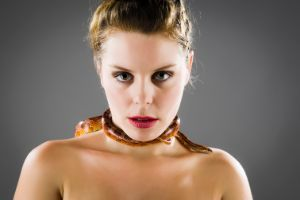 corn snake around woman's neck